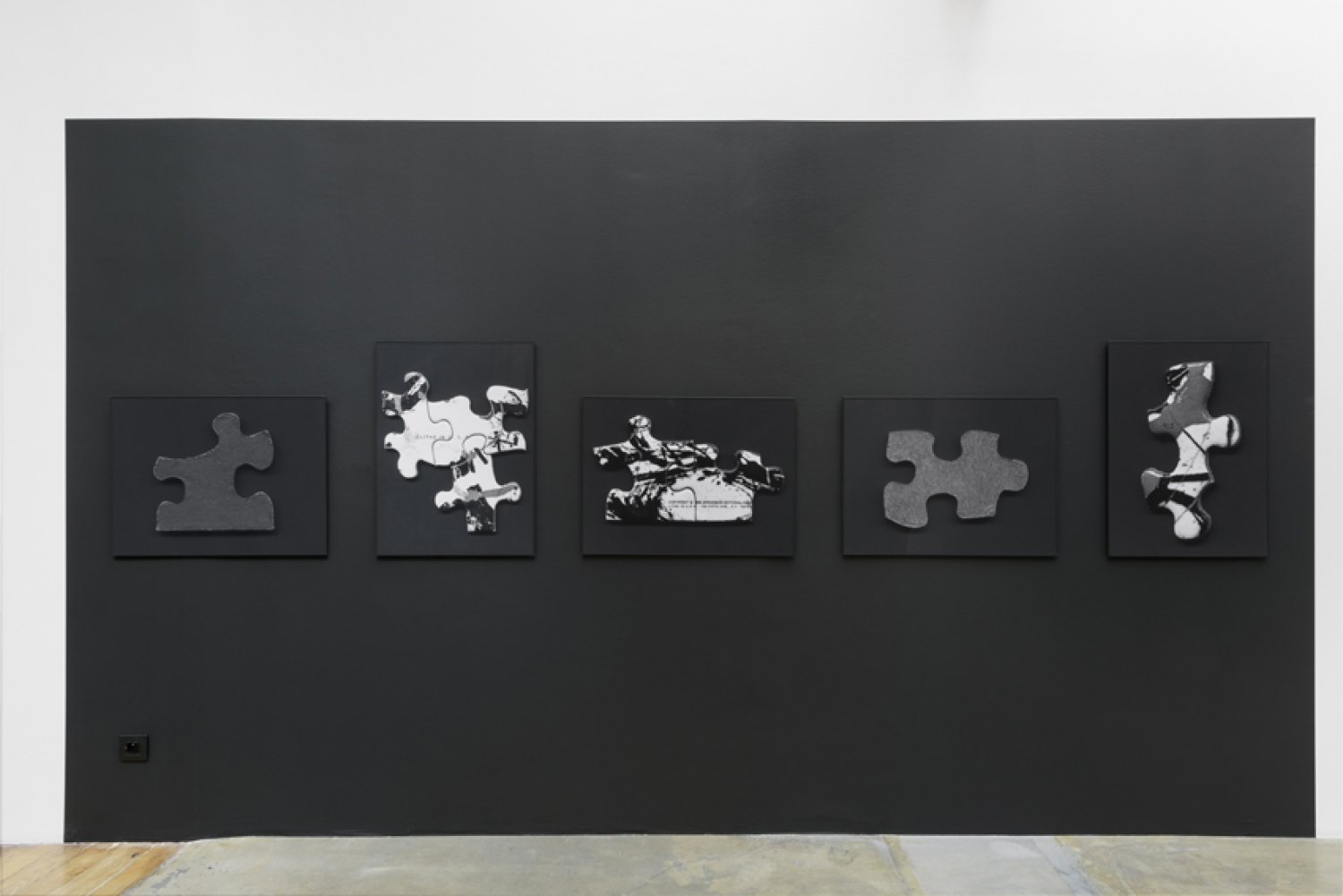 Sean Snyder Reconstruction, 2016 5 b/w archival pigment prints on matte paper, 51.75 cm x 69 cm, 1 cm black aluminum frame, installed on wall painted RAL 9017, 229 cm high x 400 cm wide