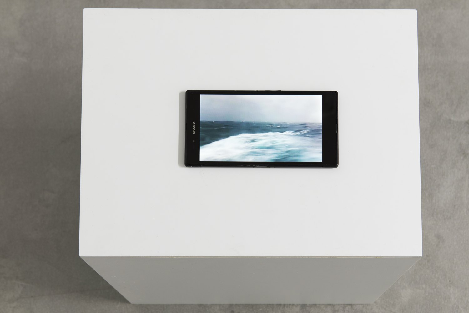 Sean Snyder Tableau Bateau, 2016-2017 random video loop with audio on hacked Sony Xperia Z Ultra, displayed on PVC structure, 40 cm x 40 cm x 30 cm