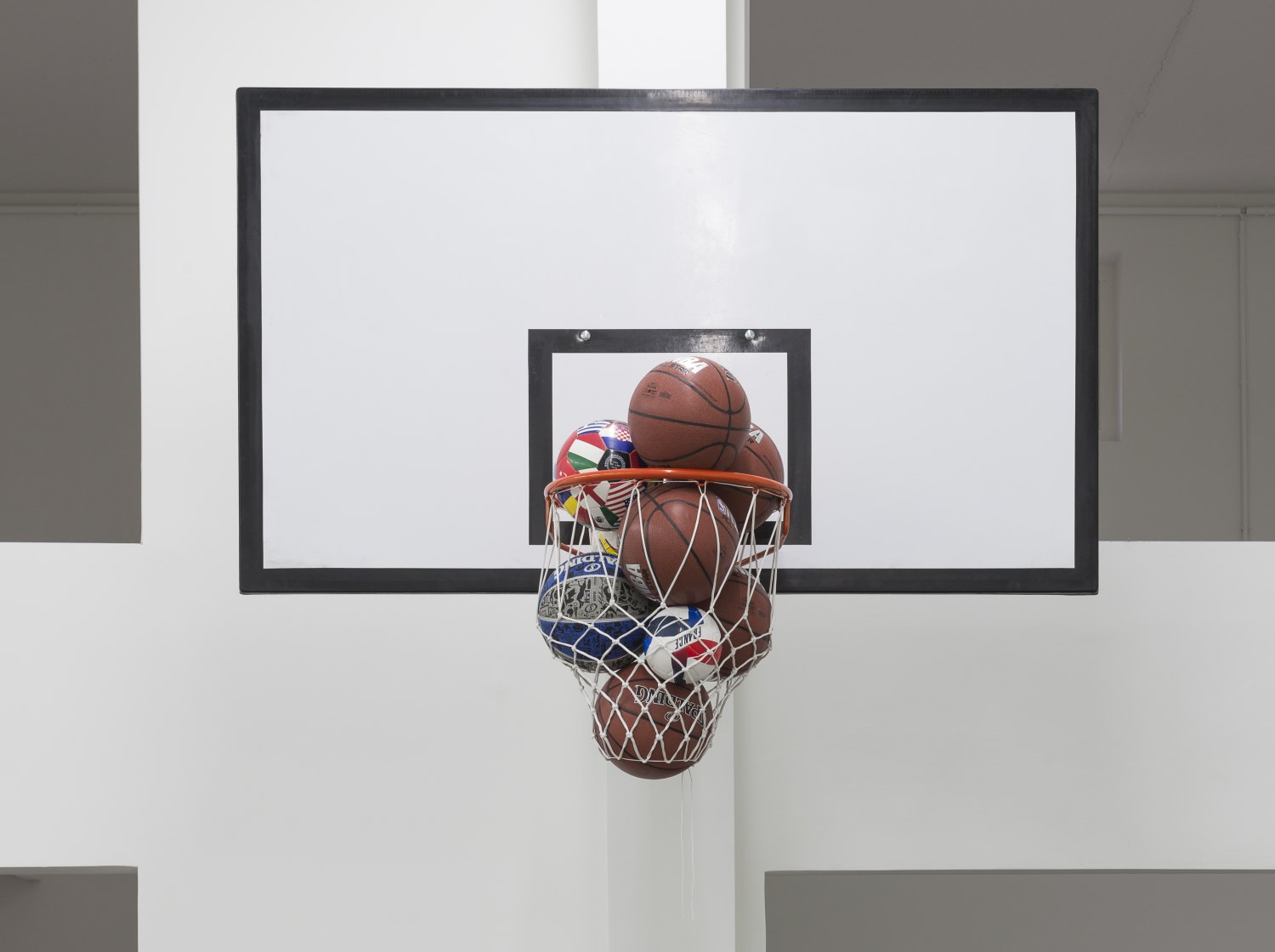 Claire Fontaine Caught, 2016 Basketball backboard, support, basketball hoop, net and various balls, 140 x 180 x 110 cm