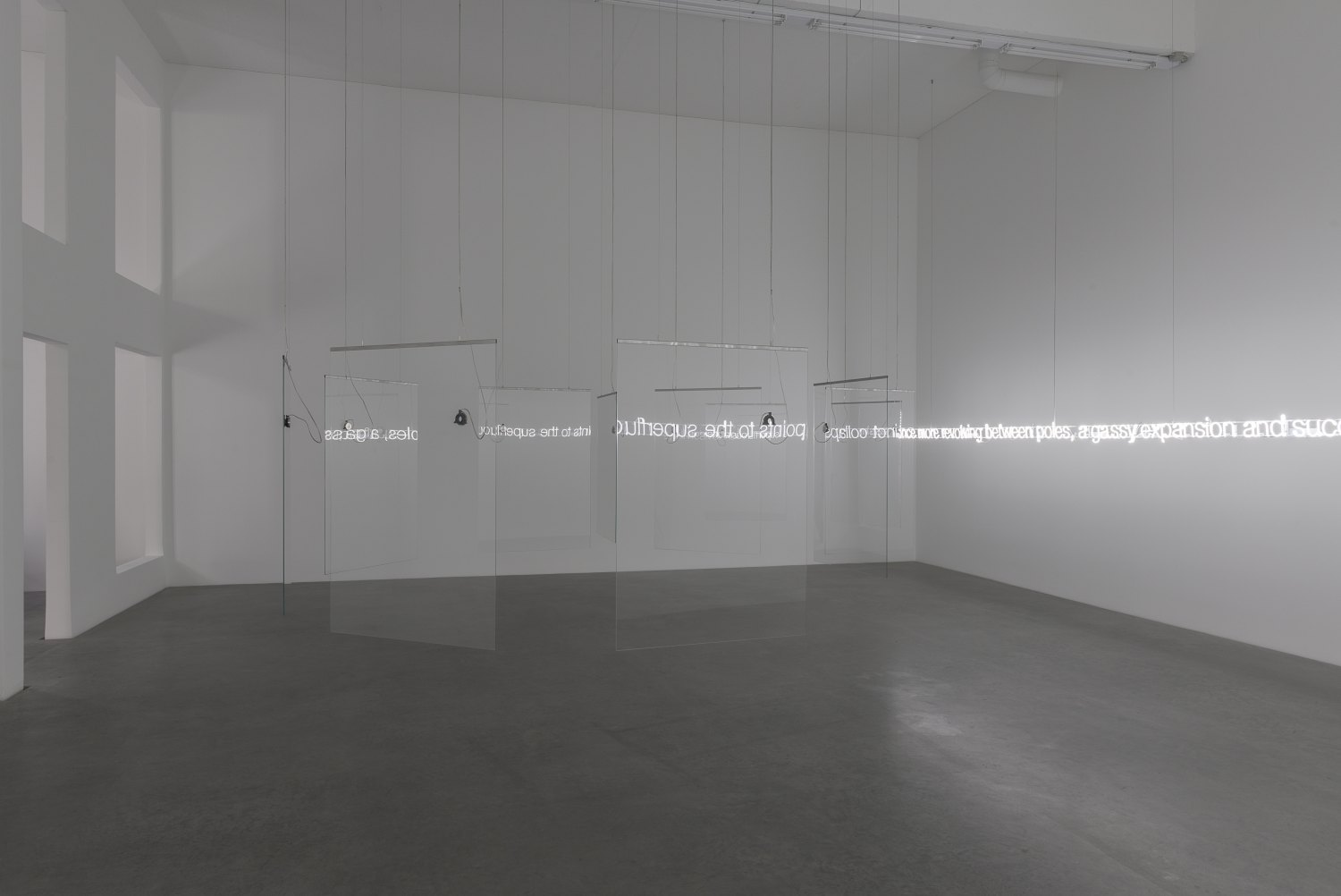 Cerith Wyn Evans 'E=L=A=P=S=E' in Glass with sound, 2016 (installation view) 11 pieces toughened low iron glass, 5 channel audio, 11 speakers, 3 amplifiers, 1 WavePlayer8, clear audio wire, 1mm stainless steel cable 196 x 520 x 470 cm