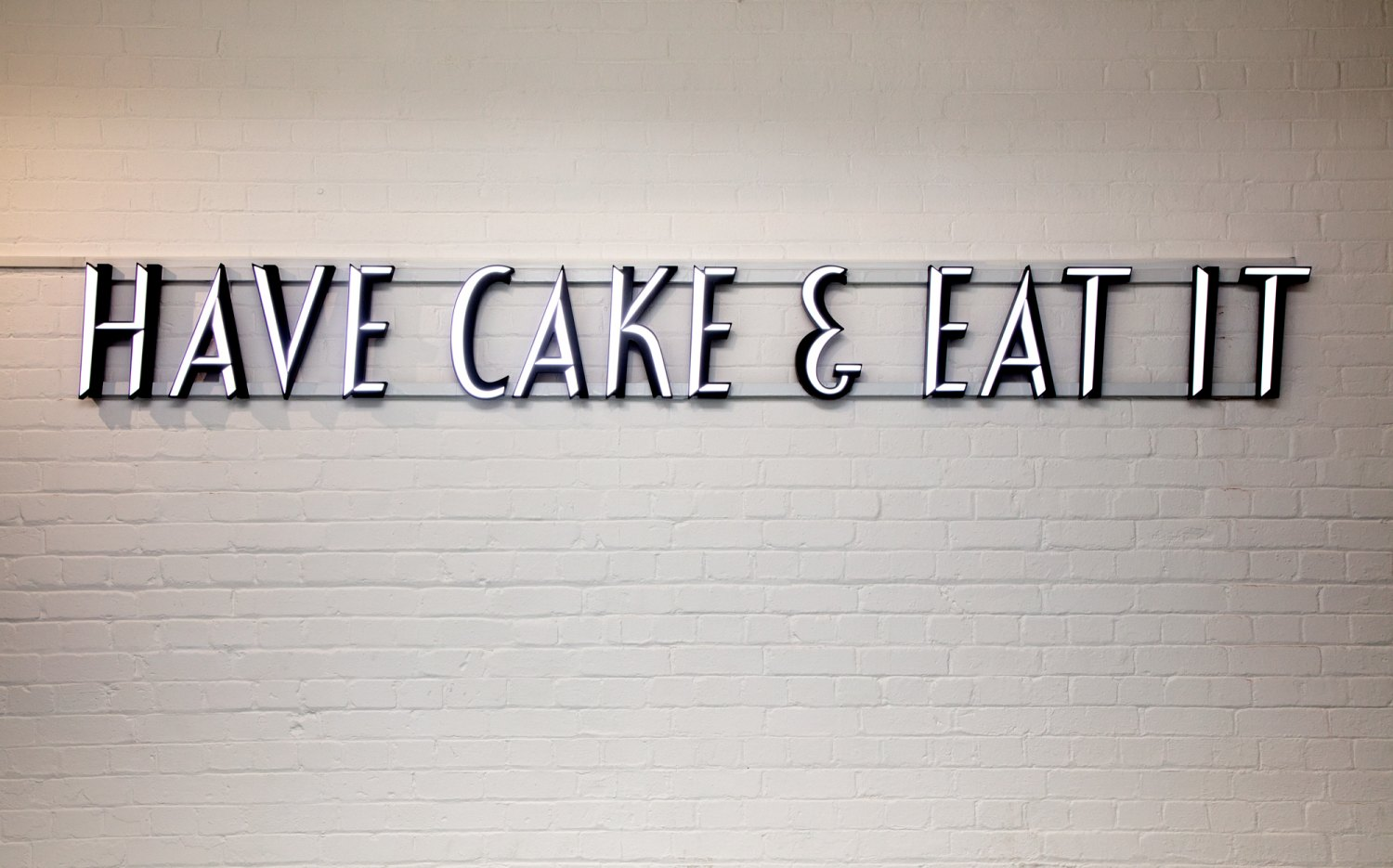 Claire Fontaine Untitled (Have cake & eat it), 2017 LED 3d 2 tone lettering with support, 33 x 302.5 x 6 cm