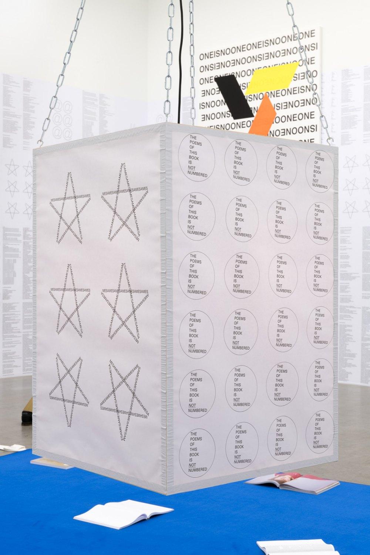 Karl Holmqvist Untitled (DIN A1 poster lantern), 2021 DIN A1 posters, wood, chains, hooks, LED lightbulb dimensions variable