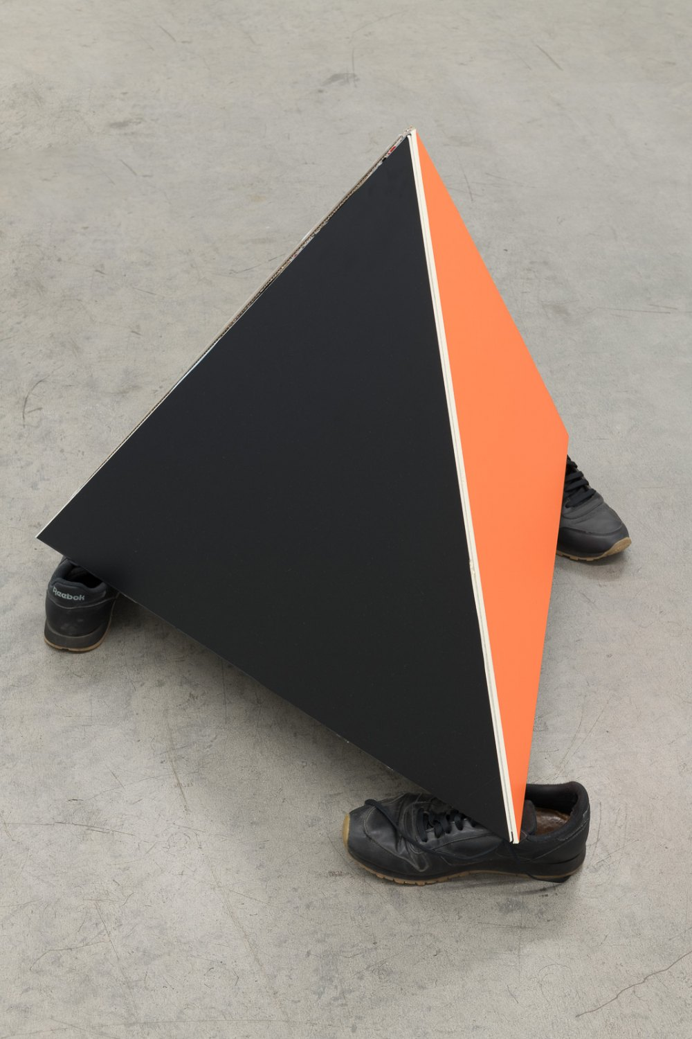 Karl Holmqvist Untitled (Foam core board pyramid), 2021 Gift wrapping paper and self-adhesive colored film on foam core board, gaffa tape, shoes dimensions variable