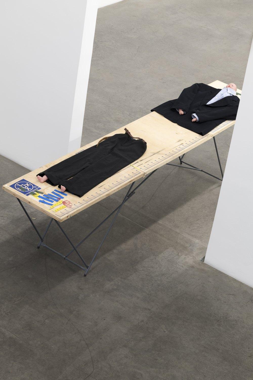 Win McCarthy Assembly of Mr. Innocent, 2021 90 x 2,955 x 58 cm Shop table, suit jacket, shirt, slacks, belt, babydoll