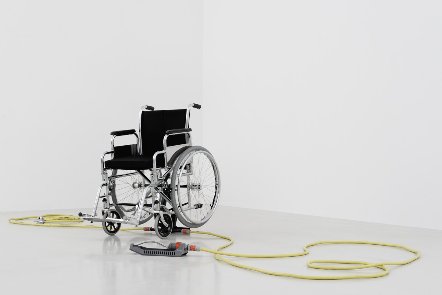 Andreas Slominski Untitled, 2000 Wheelchair, garden hose, sprinkler, plastic, metal, 112 × 66 × 96 cm