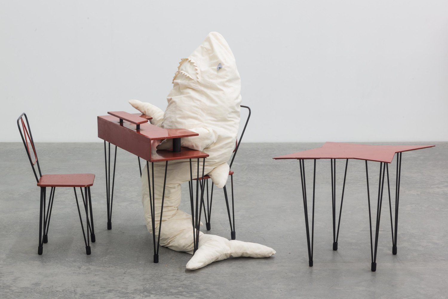 Cosima von Bonin  HAI AM TISCH 1, 2014    Iron, blockboard, lacquer, rubber, cotton, terry, foam material, polyfill, bulb with fitting, cable, galvanized steel,  150 × 50 cm (shark), 85 × 74 × 34 cm (table), 31 × 76 × 40 cm (chairs)